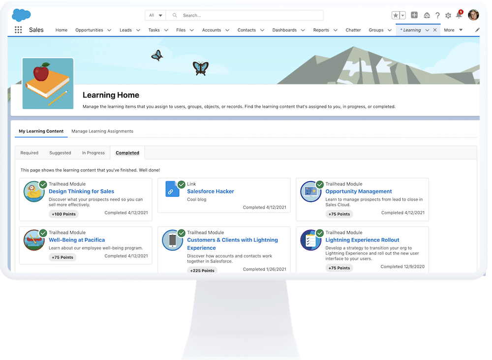Image of a computer with Salesforce Learning Paths displayed on the screen.